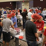 The ICLP raised $7,500 to pack 30,000 meals with Stop Hunger Now